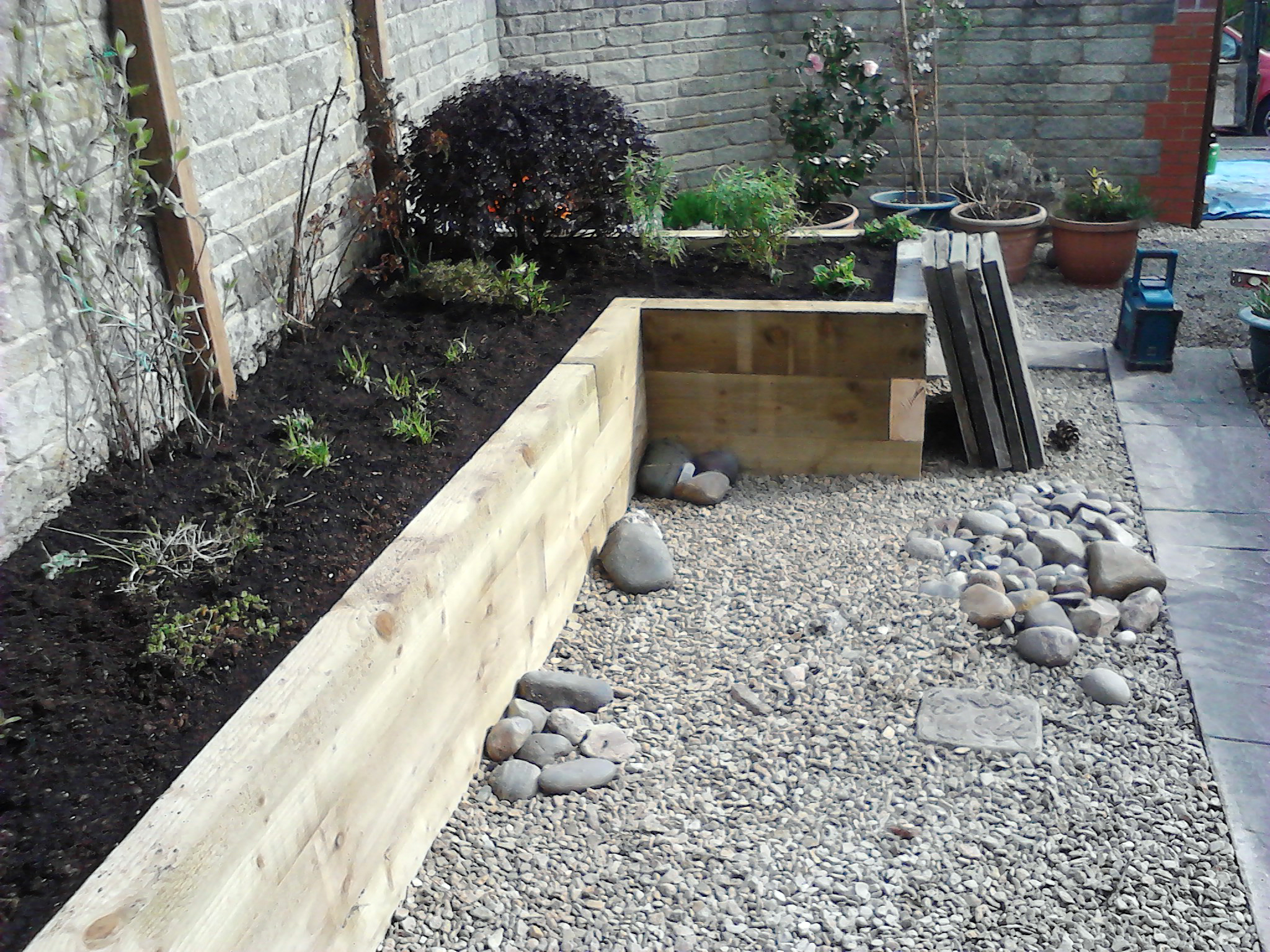 Railway sleepers as garden features j b lanscapes for Garden pond design using sleepers