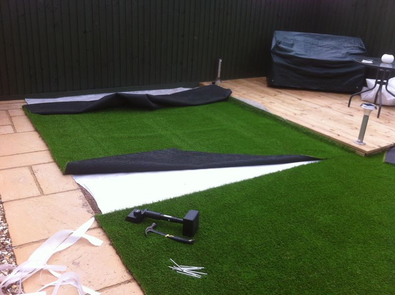 Layiing artificial grass back garden Bristol