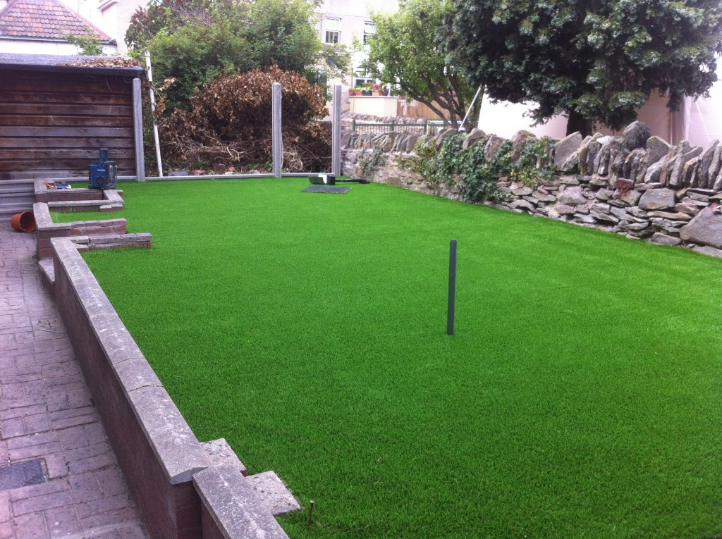 Laying artificial grass in back garden bristol
